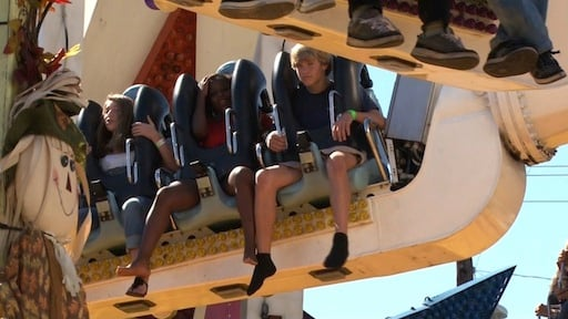 Teens enjoying their ride on the Space Roller