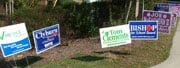 Signs are clustered around the entrance of the Greenview precinct.
