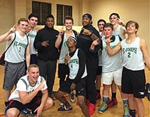 Kelsey Griffin (right center) and former South Carolina wide receiver Pharoh Cooper pose with Griffin's church league team, the NBA All Stars. The defenisve tackle spent two seasons coaching a group of students.