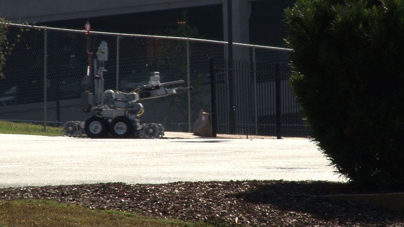 A police robot checking the suspicious package