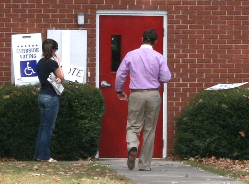 Lexington voters walk in to the Providence Church precinct.