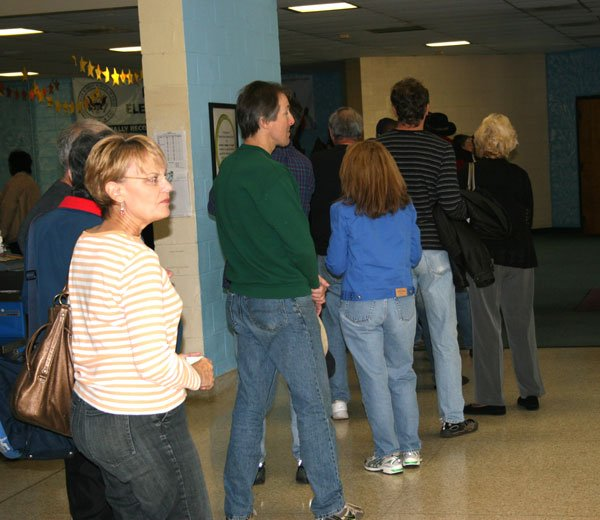 Voters keep to themselves while waiting in line at Nursery Elementary School in Irmo.