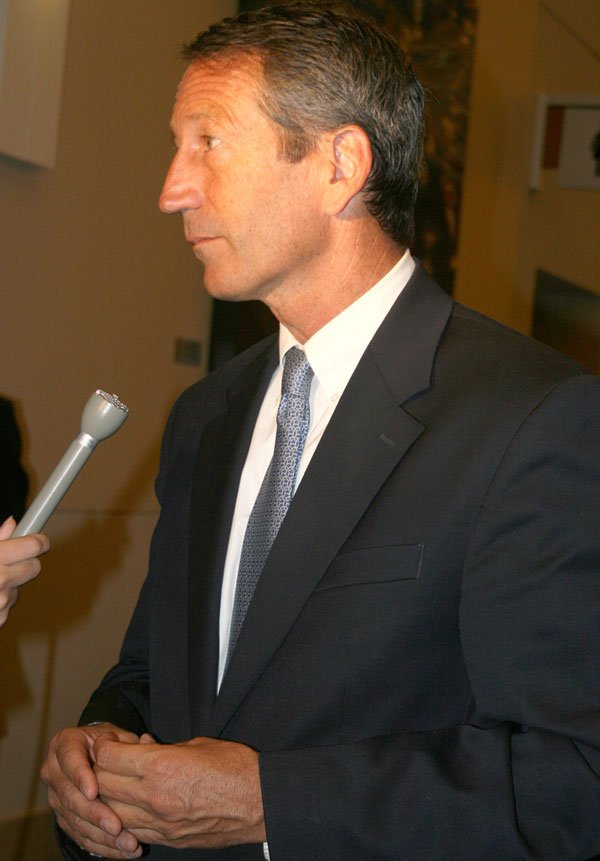 Gov. Mark Sanford arrives with a confident smile on his face in support of Nikki Haley.