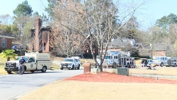 Fire crews arrived early Tuesday morning to find four dead inside the home