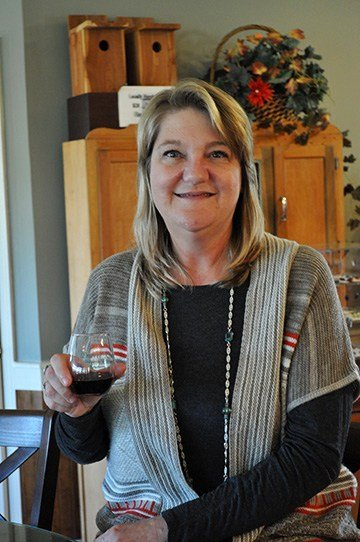 "Laura LaBarre, co-owner of Enoree River Winery, enjoys a glass of cabernet sauvignon. Her winery doesn't ""oak"" the red wines in barrels or with wood chips — a choice that gives their wine a smoother sip while still being dry."