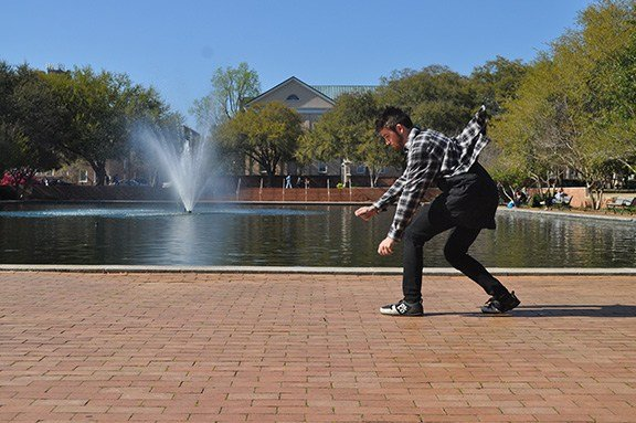 Tanner Rogers prepares to take flight outside the University of South Carolina Library.