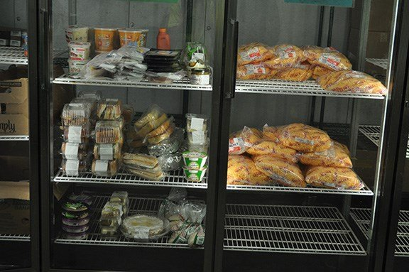 Sandwiches and saleds are kept in the fridges to distribute to the area of Columbia. Harvest Hope proportions its food by the number of children in the family as to not over distribute.