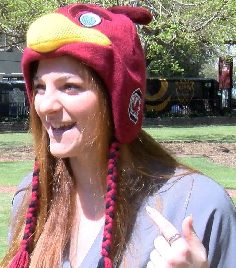 Justine Palis says her lucky hat is going to win the game.