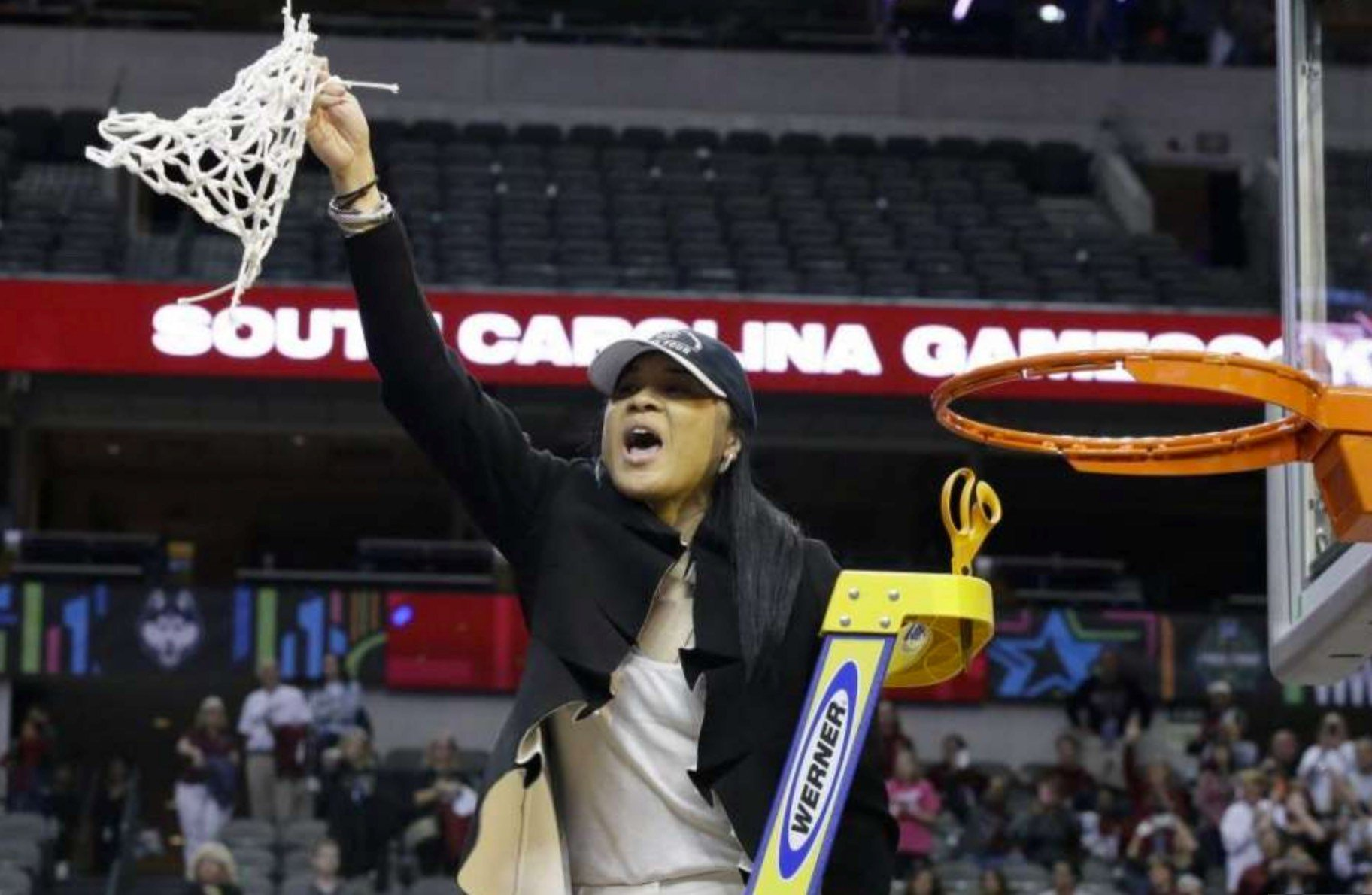 Dawn Staley cut the net on her first NCAA national championship. Staley is only the second African-American coach to win the title.