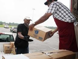 Volunteers load food for delivery to distribution points in the Midlands.