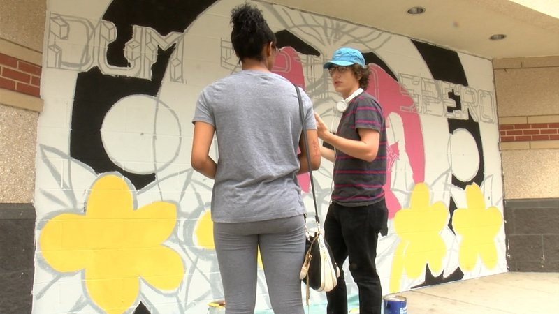 Alex Rusnack says his favorite part of painting his mural has been interacting with people who walk by.