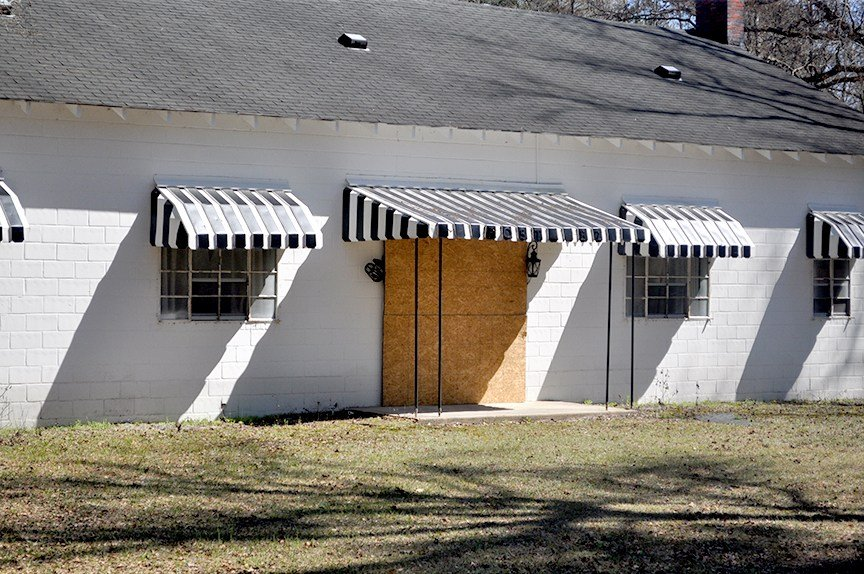 Almost every building in Nichols is boarded up like the American Legion from flood damage. All of Nichols' businesses and churches were damaged by the flooding.