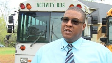 Karim Johnson says his bus company won't be able to surviveif the seat belt bill passes.