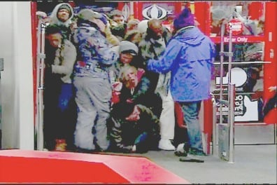 Target shoppers trample each other as the doors opened Friday Morning.