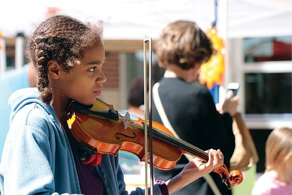 Danka can be seen at the Soda City Market on Saturdays. She's 11 years old and is performing to raise money for her violin lessons.