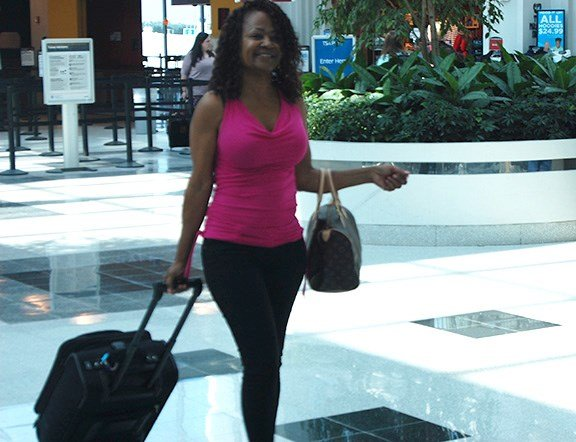 Debra Lynn, a passenger traveling back to her hometown of Houston, arrives at the Columbia airport for her flight.