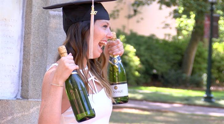 Senior Brooke Gaberiel taking graduation pictures on the Horsehoe.