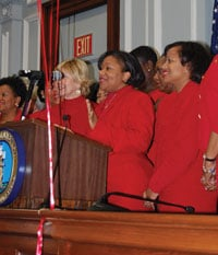 Columbia City Council member Tameika Isaac Devine delivers a short speech before posing for a group photo on the eve of the citywide and statewide Red Dress Day, an event to raise awareness of heart disease risk in women.