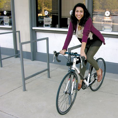 Tas Anjarwalla likes to ride bikes. Unfortunately, she spends most of the daylight in USC's Coliseum, but she does take any opportunity she can to get out for a ride. (Amy Smith / The Carolina Reporter)