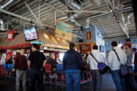 Customers stand in line by the doorway of Tin Roof at 11:30 a.m. Monday. Inside they can eat quesadillas, sandwiches, salsa and salads.