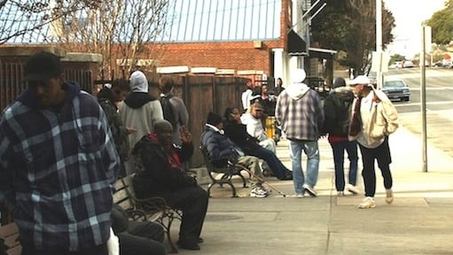 Riders wait for buses at Sumter St. Transit Station for a city bus.