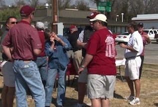 Baseball fans tailgate at the corner of Blossom and Williams to get ready for the game