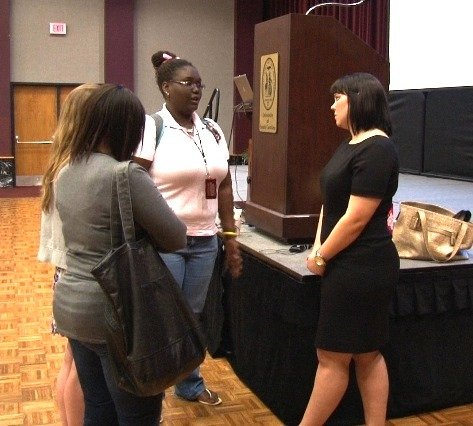 Stacy Nadeau speaks with students after her presentation.