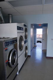 """Clean of Heart will have three washers and dryers. Bill Gilbert, president of SLM Commercial Laundry Products in Belton, donated all but one of the units. """"I just thought it was our time to chip in and see what we could do to help out,"""" Gilbert says."""