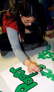Columbia Norml will hold its first rally in support of legalization of marijuana at the State House on April 20. To prepare for the event, Kristyn Sanito painted posters with other members at the Feb. 1 meeting at the Unitarian Universalist Church.