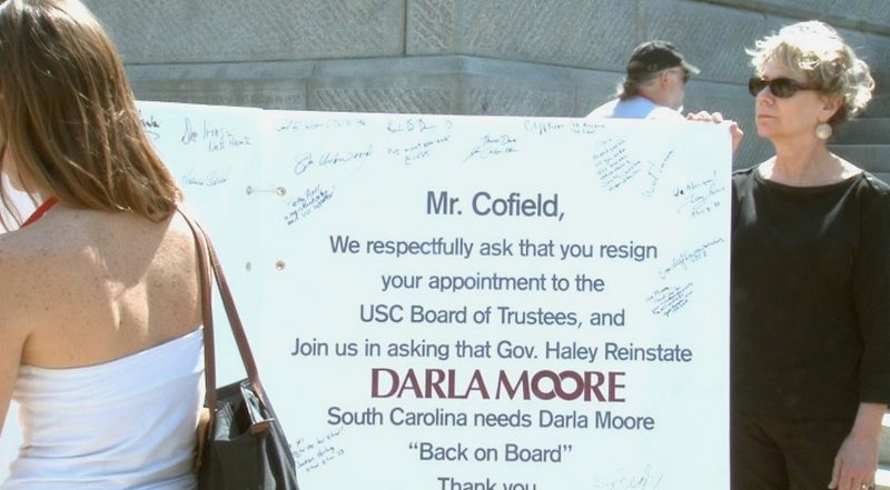 Protestors signed cards asking Cofield to step down.