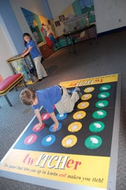 Students from Oakwood Christian School play a game of twITCHer at EdVenture Tuesday on their class field trip.