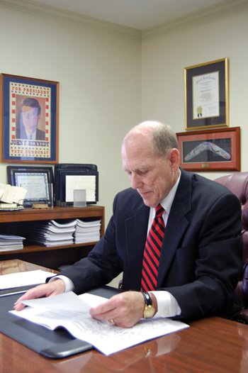 Mike LeFever, President of South Carolina Independent Colleges and Universities, goes over documents in preparation for the celebration.