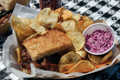 "Bone-In chef Scott Hall writes all of his own recipes, like the one for this pepper-vinegar pulled pork on focaccia with coleslaw and potato chips. ""One of the best times to come up with ideas is when I'm partying,"" said Hall."