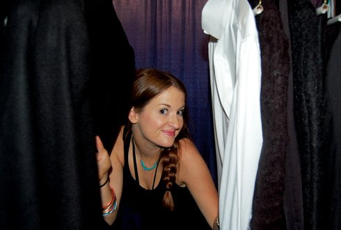 Logan Phillips, a fashion merchandising student at USC, works backstage as a runway assistant.