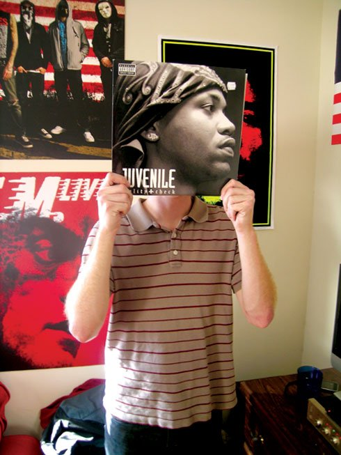 "Douthit holds his copy of Juvenile's ""Reality Check,"" which was released on vinyl five years ago."