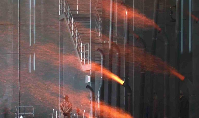 Fire embers shoot out during the testing