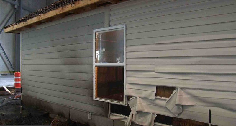 The fiber cement board siding holding up much better than the vinyl next to it