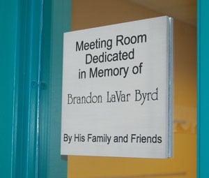 A sign commemorating Cynthia Byrd's son welcomes visitors to a conference room at the Richland County Public Library's St. Andrews branch.
