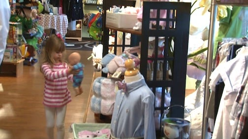 One young shopper checks out a baby doll at Bumble Boutique in Columbia