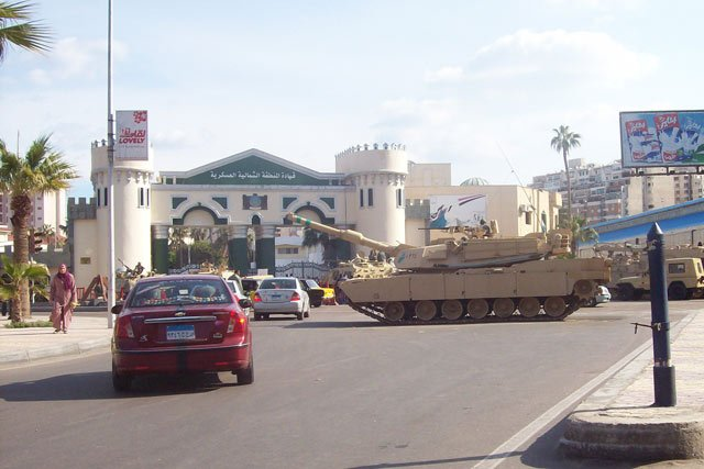 Troops guard the northern military headquarters building in Alexandria