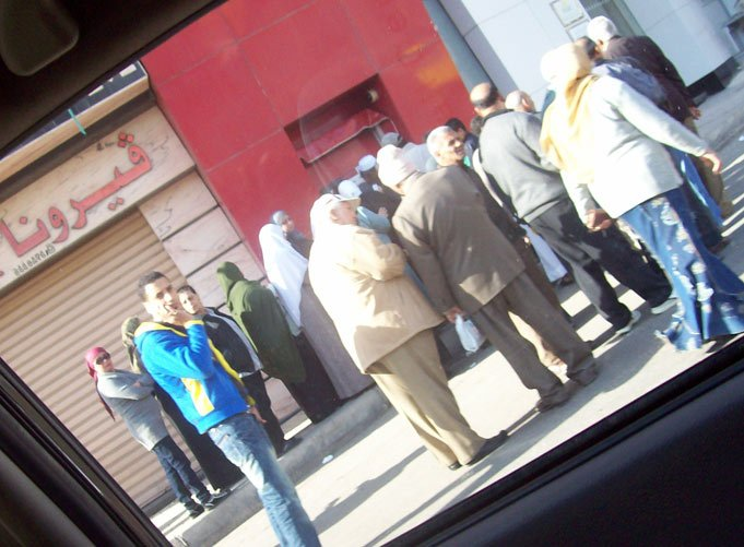 People withdraw money from ATMs because all banks were shut down