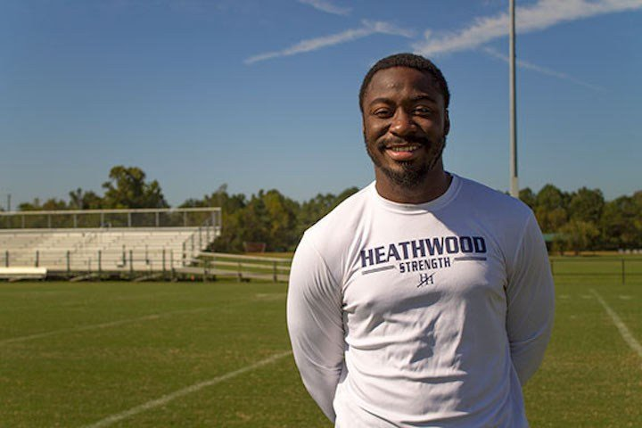 Marcus Lattimore, now the head coach at Heathwood Hall Epsicopal High School, stands on the football field that he now coaches on.