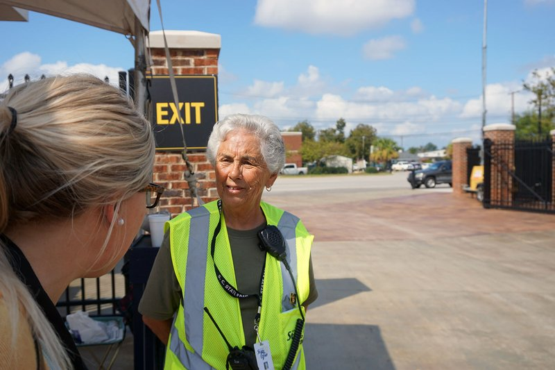 Gate attendant Pat Roberts directs workers and vehicles through the State Fair gate in front of the rocket during preparation week. She said it will close Wednesday morning when visitors are allowed to enter the park.