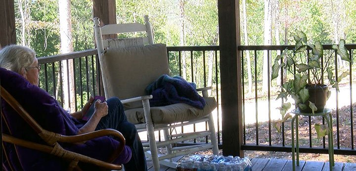 On the porch, Stansfield takes in nature while living inside a new community.