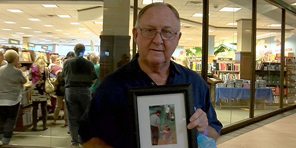 Bob Self, Fox & Friends fan, holds a 36 year old picture of his daughter that's similar to Ainsley's book cover.