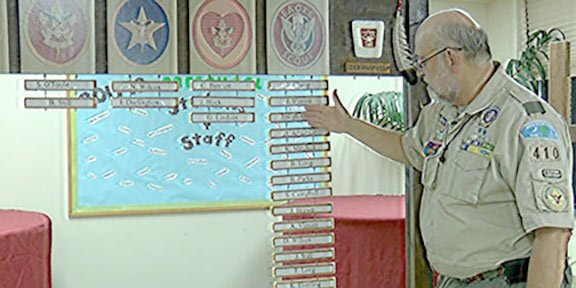 Jackson showcases all of the boys he helped to become Eagle Scouts on Troop 410's rank board.