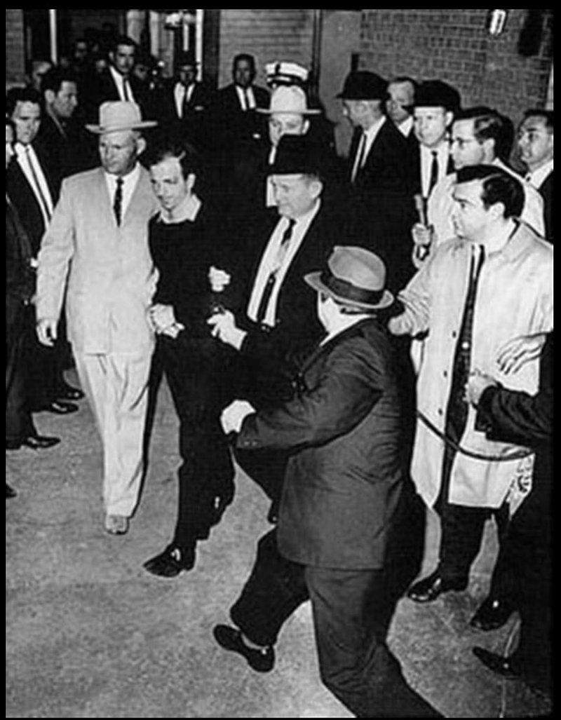 Lee Harvey Oswald, taken into custody and accused of the assassination of President Kennedy, is shot on live TV in police headquarters.