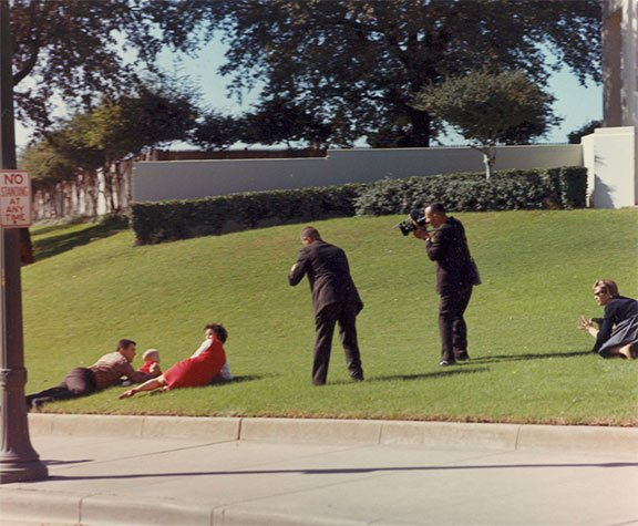 Witnesses to President Kennedy's assassination took cover after shots were fired on Nov. 22, 1963.