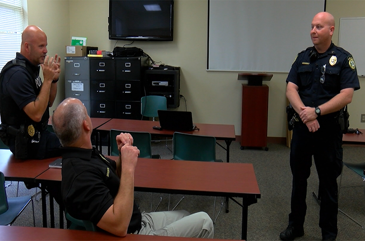 The officers at the West Columbia Police Department discuss which co-workers they believe will have the longest beard.
