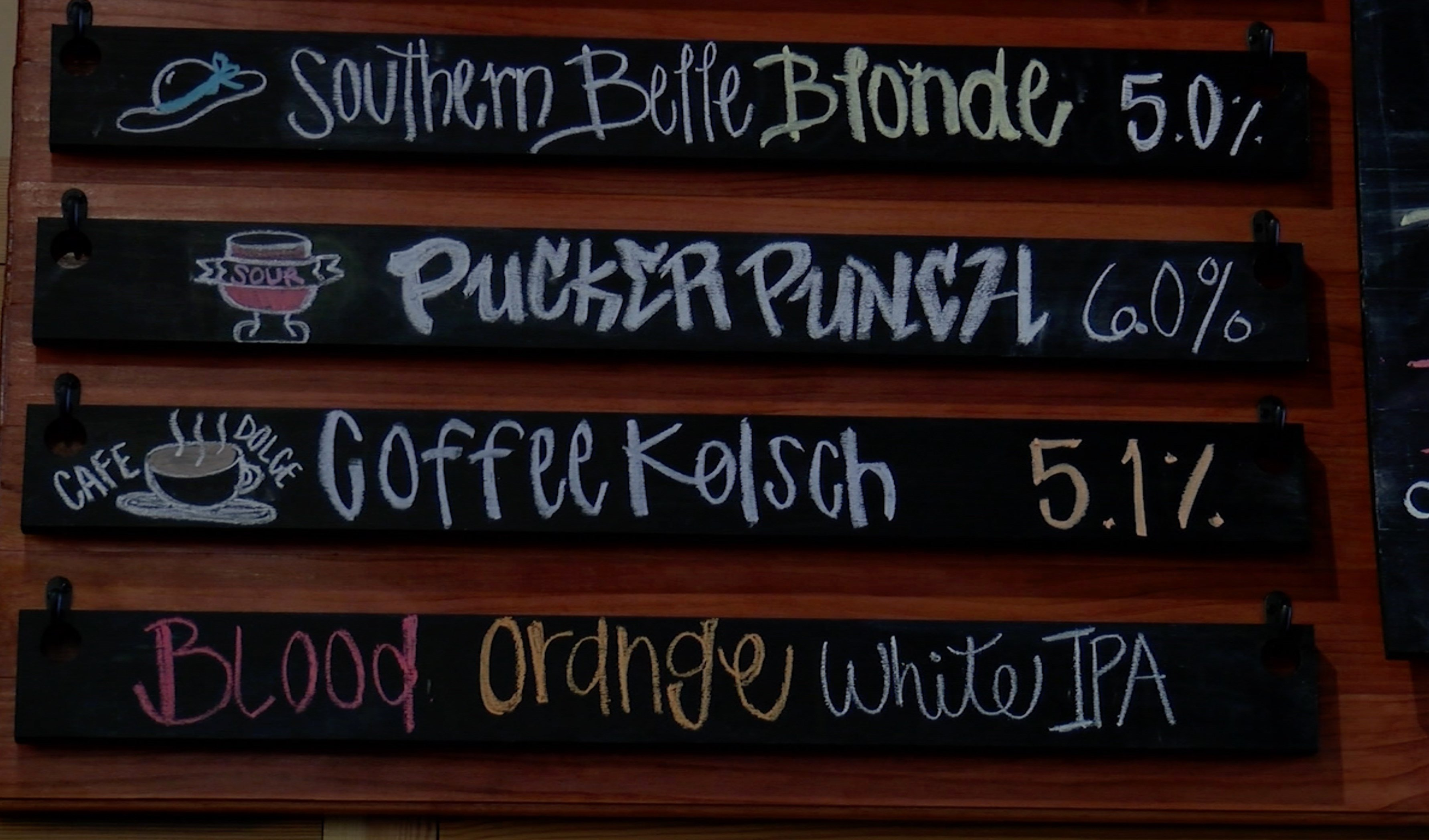 Twisted Spur's drink board advertises multiple craft beer selections.
